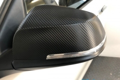 BMW 1-Series wing mirrors wrapped in carbon fibre